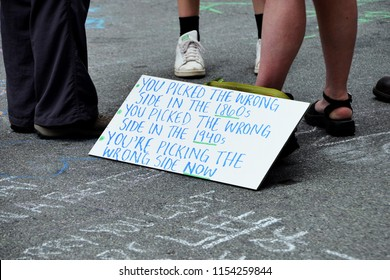 CHARLOTTESVILLE, VA – Aug 11, 2018: A protester's sign in the Downtown area of Charlottesville on the one anniversary of a rally that turned violent.