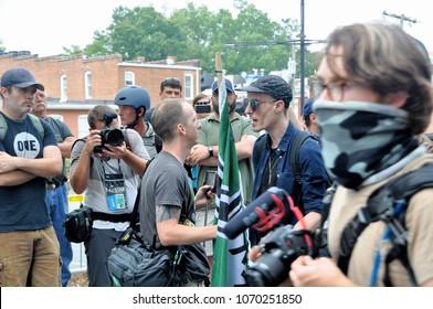 CHARLOTTESVILLE, VA - August 12, 2017: A white rights supporter & counter activist clash during a white nationalist rally that turned violent resulting in one death.