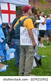 CHARLOTTESVILLE, VA - August 12, 2017: Counter protesters gather in McGuffey Park, a refuge of peace during a white nationalist rally that turned violent resulting in one death and multiple injuries.