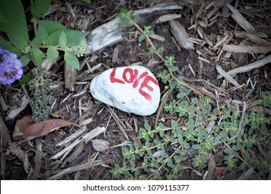 CHARLOTTESVILLE, VA - August 2017: A handpainted rock in support of Heather Heyer is placed at the base of the Robert E Lee statue. Heyer was killed when a car plowed into a crowd of protesters.