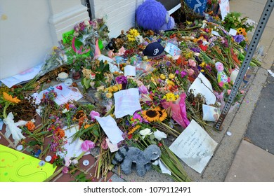 CHARLOTTESVILLE, VA - August 2017: Memorial flowers and notes are left at the spot where Heather Heyer was killed and others were injured when a car plowed into a crowd of protesters during a rally.