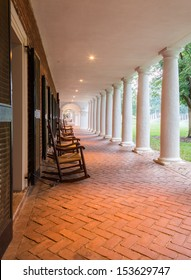 CHARLOTTESVILLE, VA - AUGUST 28: Rocking chairs in the walkway under portico on the campus of University of Virginia on 28 August 2013. Designed by Thomas Jefferson as an Academical Village