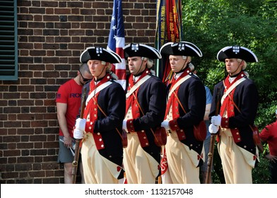 CHARLOTTESVILLE, VA – July 4, 2018 – Colonial soldiers present the flag at the citizenship ceremony held at Jefferson's Monticello in Charlottesville, Virginia.