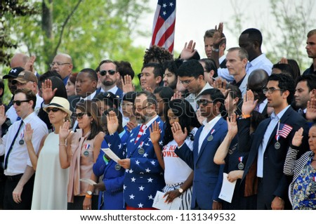 CHARLOTTESVILLE, VA – July 4, 2018 – A community members help celebrate with 67 immigrants from 35 countries as they gain their citizenship on the steps of Thomas Jefferson's Monticello.