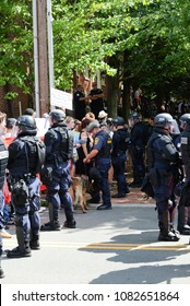 CHARLOTTESVILLE, VA – July 8, 2017: Charlottesville police maintain a barrier between members of a NC group and a much larger number of counter-protesters gathered in opposition.