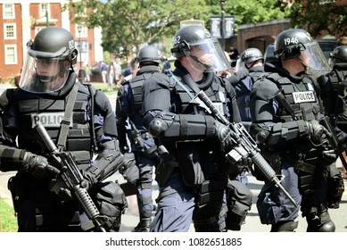 CHARLOTTESVILLE, VA – July 8, 2017: Charlottesville police maintain a barrier between members of a NC KKK group and a much larger number of counter-protesters gathered in opposition.