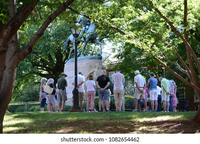 CHARLOTTESVILLE, VA – July 8, 2017: Counter protesters gather early in the day to pray for peace around a statue of Stonewall Jackson where later members of a NC KKK group will rally.