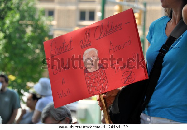 CHARLOTTESVILLE, VA – June 30, 2018: Protesters gather to speak out against the U.S. government's policy of separating children from their parents who cross the southern border.