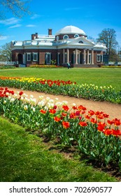 Charlottesville, Virginia - USA - April 20, 2014: Tourists walk across the lawn of Thomas Jefferson's Monticello - a UNESCO World Heritage Site.