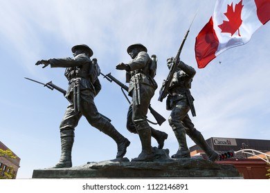 CHARLOTTETOWN PEI, CANADA - June 13th, 2018: Bronze sculptures of the National War Memorial at Charlottetown Prince Edward Island Canada, which commemorates the sacrifice of Canadians in time of war.