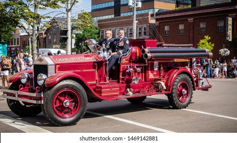 Charlottetown, Prince Edward Island, Canada - August 17 2018: Antique fire truck from Fire Department on the street during Gold Cup Parade to celebrate the PEI's Old Home Week and summer in downtown