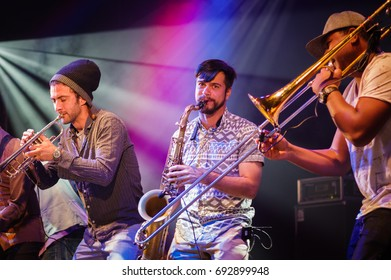 Charlton Park, UK - July 27 2017: Musicians from the Brazilian group 'Bixiga 70' performing at the Womad Festival in Charlton Park.