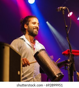 Charlton Park, UK - July 27 2017: Musician from the Brazilian group 'Bixiga 70' performing at the Womad Festival in Charlton Park.