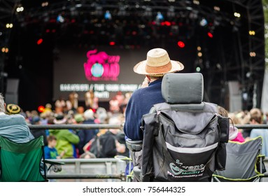 Charlton Park, UK - July 28, 2017: Man on the disabled viewing platform for the main stage at Womad Festival in Charlton Park.