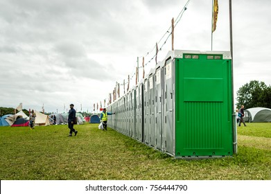 Charlton Park, UK - July 28, 2017: Row of portable toilets in the camping grounds of Womad Festival in Charlton Park.
