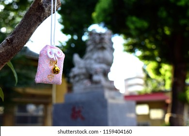 "A charm and scenery of Japanese shrine. Japanese kanji appear in an image are ""Omamori"", that mean ""lucky charm""."