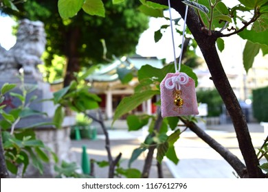 """A charm and scenery of Japanese shrine. Japanese kanji appear in an image are """"Omamori"""", that mean """"lucky charm""""."""