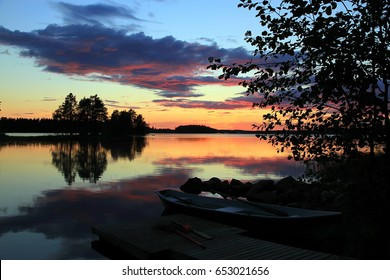 The charm of summer sunset on the lake, Finland