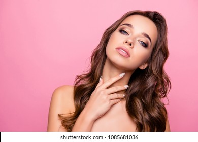 Charming, adorable, pretty girl touching her skin after scub, mask, having good, fresh, natural effect, isolated on pink background, wellness and wellbeing concept