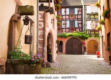 charming alley in medieval village Riquewihr, Alsace, France