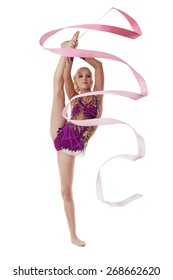 Charming artistic gymnast dancing with pink ribbon