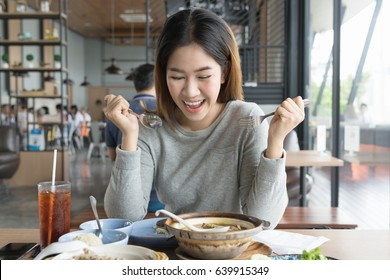 Charming asian woman is starting have lunch action. Feeling happy ,excite and enjoy to eating.