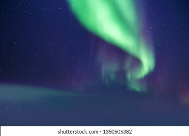 Charming aurora borealis shoot from the Svalbard island located in the north of norway.