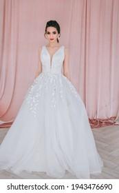 Charming and beautiful bride in luxury fashion wedding dress in studio