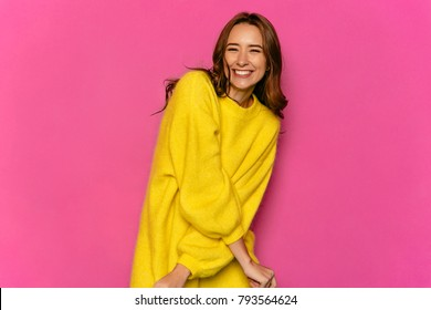 Charming beautiful girl , smiling widely, waiting for Valentine's day. Dressed in yellow sweater. On pink background.