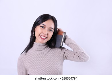 Charming beautiful tan skin Asian confident woman hand holds hold book. Back to school concept.