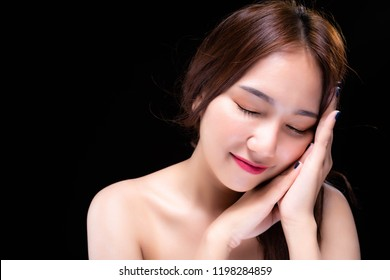Charming beautiful woman wants telling someone that good sleep or sleep well all night gets good health and good emotions. Attractive beautiful girl has nice skin and beautiful face. Black background