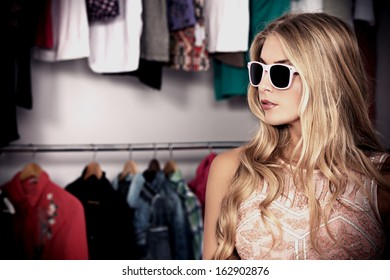 Charming blonde girl in sunglasses.