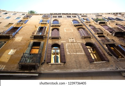 Charming brcik exterior and windows of old Italian buildings in European style
