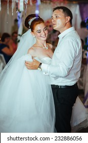 Charming bride and groom dancing on their wedding celebration in a luxurious restaurant. wedding dance of bride and groom