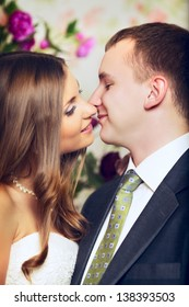 charming bride and groom kissing, close up portrait