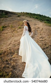 The charming bride is on the hillside