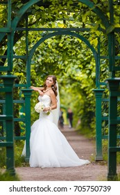 Charming bride in the park