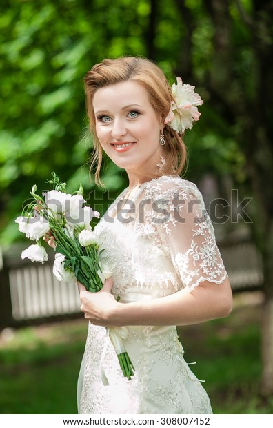 Charming bride in vintage dress with French braids, and a sweet smile, a wedding day