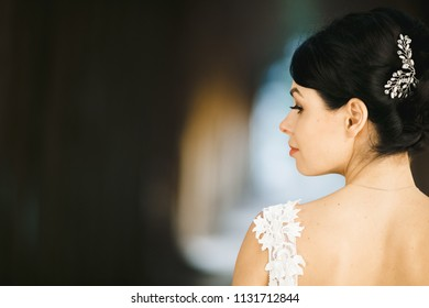 The charming bride walking along alley