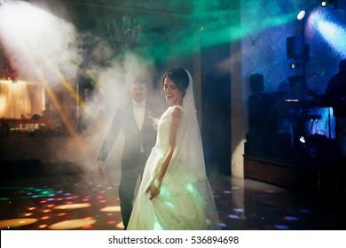 The charming brides dancing on the dancefloor
