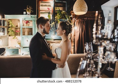 The charming brides embracing in restaurant