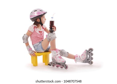 Charming broun-haired girl of school age in short jeans shorts and a pink t-shirt sitting on the chair and tries to foot roller skates. Isolated on white background