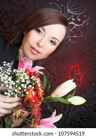 Charming brunette with flowers in her hands