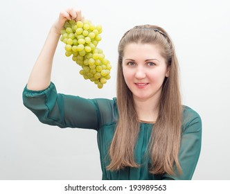 charming cheerful girl with grapes