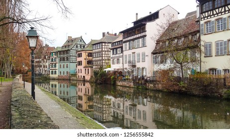 charming colorful half timbered houses above the river in La Petite France quartier (Little France) in Strasbourg city, Alsace region, eastern France close to borders with  Germany, Europe