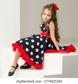 Charming Coquettish Girl Posing in Retro Fashion Dress in Studio