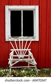 Charming Country Setting of a Chair and Barn Window