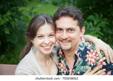 Charming couple of a man and woman sitting on the bench