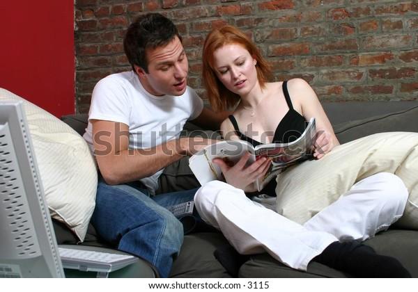 Charming Couple Reading Magazine