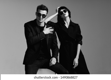 Charming couple in sunglasses elegant studio luxury style